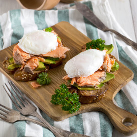 eggs and salmon muffin on serving board